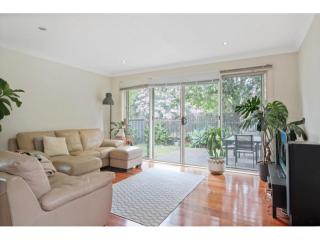 View profile: Three-Bedroom Townhouse at Wollongong!